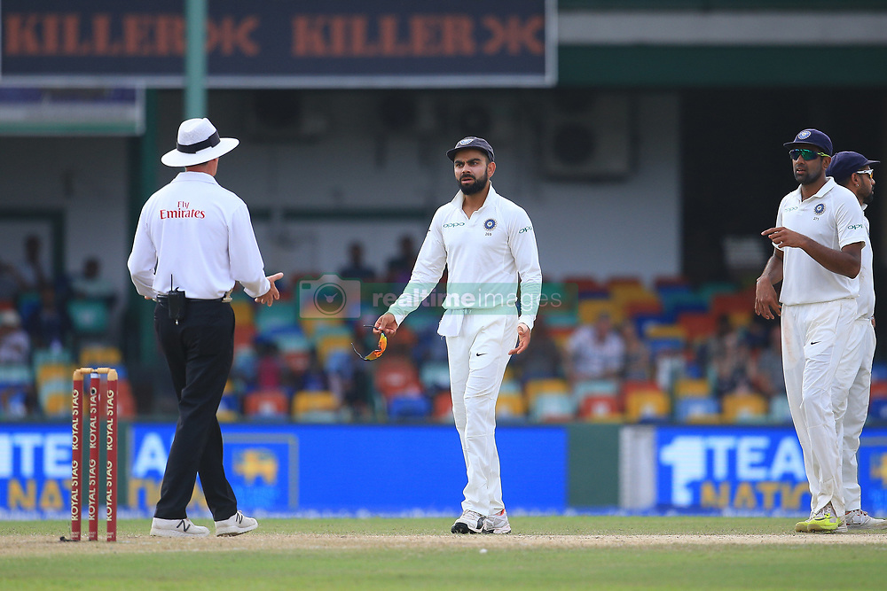 August 4, 2017 - Colombo, Sri Lanka - Indian cricket captain Virat kohli (2R) and Indian cricketer Ravichandran Ashwin(R) discuss with the on field umpire about a turned-down appeal after Kohli asked for a review during the 2nd Day's play in the 2nd Test match between Sri Lanka and India at the SSC international cricket stadium at the capital city of Colombo, Sri Lanka on Friday 04 August 2017. (Credit Image: © Tharaka Basnayaka/NurPhoto via ZUMA Press)