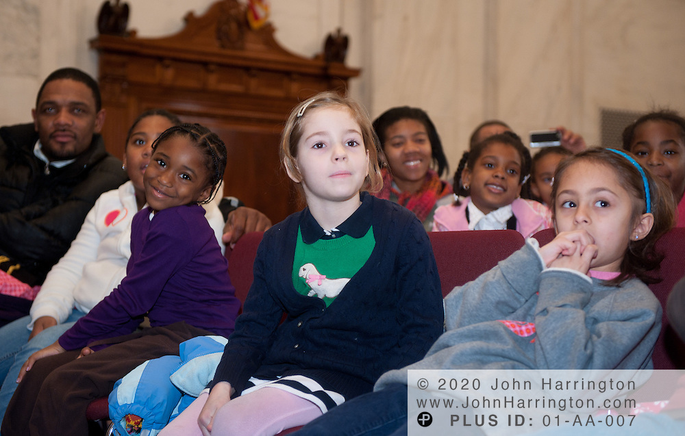 """Schoolchildren sit in the audience at a press conference announcing a new partnership between The National Children's Museum and the Sesame Workshop at the Russell Senate Office Building in Washington, DC on February 3, 2011.  The Sesame Workshop, the organization behind the television show """"Sesame Street"""" will have a permanent home in the nation's capital, a move that will expand the organization's mission of education."""