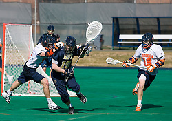 Virginia attackman Ryan Kelly (22) hits Navy Goalie Matt Coughlin (19).  The Virginia Cavaliers scrimmaged the Navy Midshipmen in lacrosse at the University Hall Turf Field  in Charlottesville, VA on February 2, 2008.
