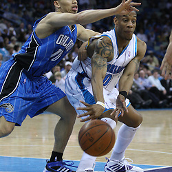 18 February 2009: New Orleans Hornets guard Antonio Daniels (50) passes the ball away from Orlando Magic guard Tyronn Lue (10) during a 117-85 win by the New Orleans Hornets over the Orlando Magic at the New Orleans Arena in New Orleans, Louisiana.