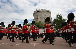 Guards band march past the Round Tower  at the Order of the Garter service at Windsor Castle, Monday, 18th June 2012  Photo by: Stephen Lock / i-Images
