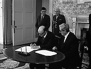 President Hillery Dissolves The Dáil. (R48)..1987..21.01.1987..01.21.1987..21st January 1987..At the request of An Taoiseach,Dr Garret Fitzgerald, President Patrick Hillery signed the Instrument of Dissolution to dissolve the Dáil and thus set in motion the general election...Image shows President Hillery signing the Instrument of Dissolution watched by Dr Garret Fitzgerald.