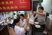 Waglong Restaurant in Pudong, Shanghai, China, where freelance computer graphics artist and internet gamer Xu Zhipeng occasionally orders his meals. (From the book What I Eat: Around the World in 80 Diets.) Twice a day Xu Zhipeng tears himself away from an online game for less than a minute to order a meal. The food is delivered to his computer station 10 minutes later, where he eats it without interrupting his game.