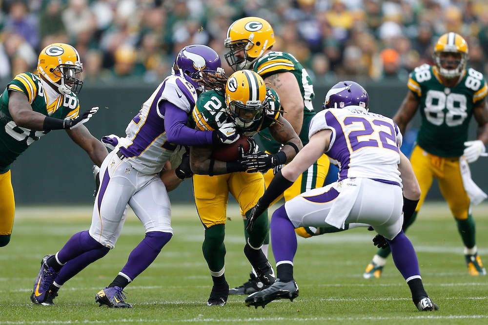 GREEN BAY, WI - DECEMBER 2:  Alex Green #20 of the Green Bay Packers runs the ball against the Minnesota Vikings at Lambeau Field on December 2, 2012 in Green Bay, Wisconsin.  The Packers defeated the Vikings 23-14.  (Photo by Wesley Hitt/Getty Images) *** Local Caption *** Alex Green