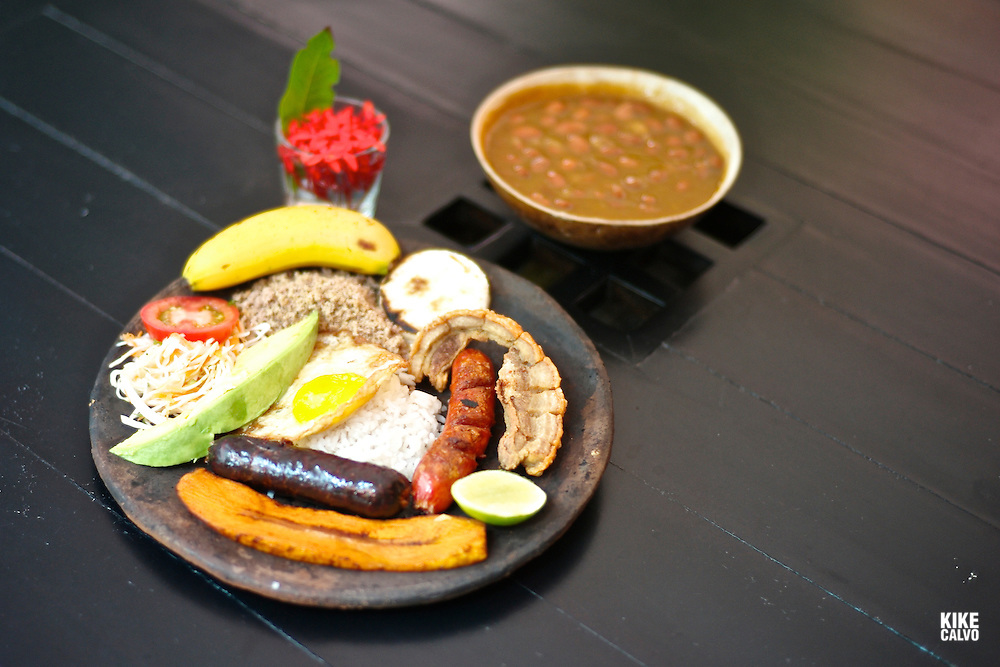 Typical ¨bandeja paisa¨a dish that combines rice, bean, avocado, arepa or corn bread fried pork known as chicharron, salad, plantain, fried egg, sauseges and meat