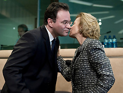George Papaconstantinou, Greece's finance minister, left, is greeted by Elena Salgado, Spain's finance minister, during an emergency meeting of euro zone finance ministers in Brussels, on Sunday, May 2, 2010. Greece accepted an unprecedented bailout from the European Union and International Monetary Fund worth more than 110 billion euros ($146 billion). (Photo © Jock Fistick)