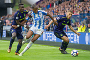 Everton midfielder Idrissa Gueye battles with Huddersfield Town Defender Terence Kongolo  during the Premier League match between Huddersfield Town and Everton at the John Smiths Stadium, Huddersfield, England on 28 April 2018. Picture by Craig Zadoroznyj.
