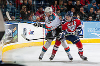 KELOWNA, CANADA -FEBRUARY 19: Marek Tvrdon #17 of the Kelowna Rockets back checks Justin Hamonic #6 of the Tri City Americans during third period on February 19, 2014 at Prospera Place in Kelowna, British Columbia, Canada.   (Photo by Marissa Baecker/Getty Images)  *** Local Caption *** Marek Tvrdon; Justin Hamonic;