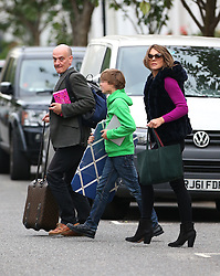 Elizabeth Hurley wearing a pink jumper, fur bodywarmer, black trousers, black boots and still without her engagement ring on, was seen leaving her London home with her son Damian... London, UK. 27/09/2013<br />BYLINE MUST READ : JAMESY/GOTCHA IMAGES<br /><br />Copyright by © Gotcha Images Ltd. All rights reserved.<br />Usage of this image is conditional upon the acceptance <br />of Gotcha Images Ltd, terms and conditions available at<br />www.gotchaimages.com