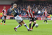 Millwall FC forward Steve Morison (20) and Sheffield United midfielder John Fleck (4) during the EFL Sky Bet Championship match between Sheffield United and Millwall at Bramall Lane, Sheffield, England on 14 April 2018. Picture by Ian Lyall.