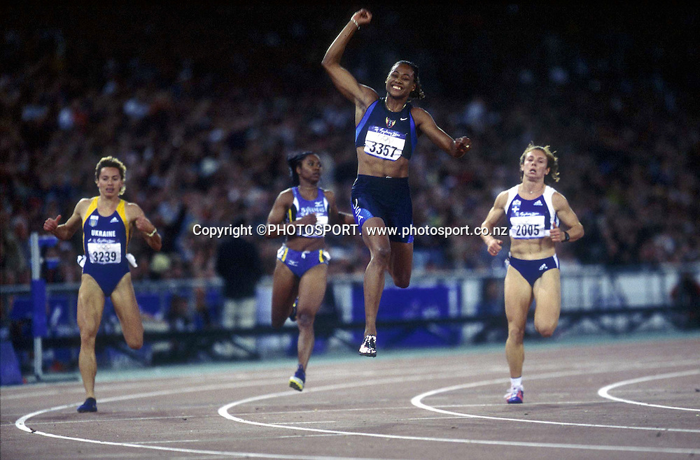 Marion Jones (USA) celebrates winning the final of the women's 100m at the Olympic Games, Sydney Australia, on September 23 2000. Photo: Andrew Cornaga/PHOTOSPORT<br />