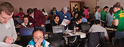 International students and student volunteers collaborate to fill out their taxes with the help of 2 Ohio University instructors and 20 student volunteer.