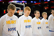 21 MAR 2015: Brothers Bryce Alford (20) and Kory Alford (2) of University of California - Los Angeles pause for the National Anthem before they take on the University of Alabama - Birmingham during the 2015 NCAA Men's Basketball Tournament held at the KFC Yum! Center in Louisville, KY. UCLA defeated UAB 92-75. Brett Wilhelm/NCAA Photos