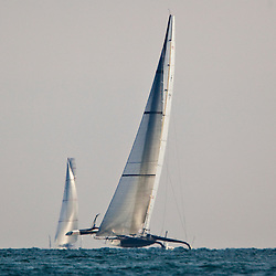 BMW Oracle ahead of Alinghi<br /> Arriving at the finish line<br /> Race1<br /> 2010 America's Cup, Valencia<br /> ©2010 Kaufmann/Forster go4image.com
