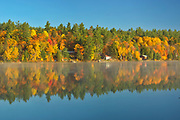 Cottages and Autumn colors along Carlyle Lake<br />Killarney Provincial Park<br />Ontario<br />Canada