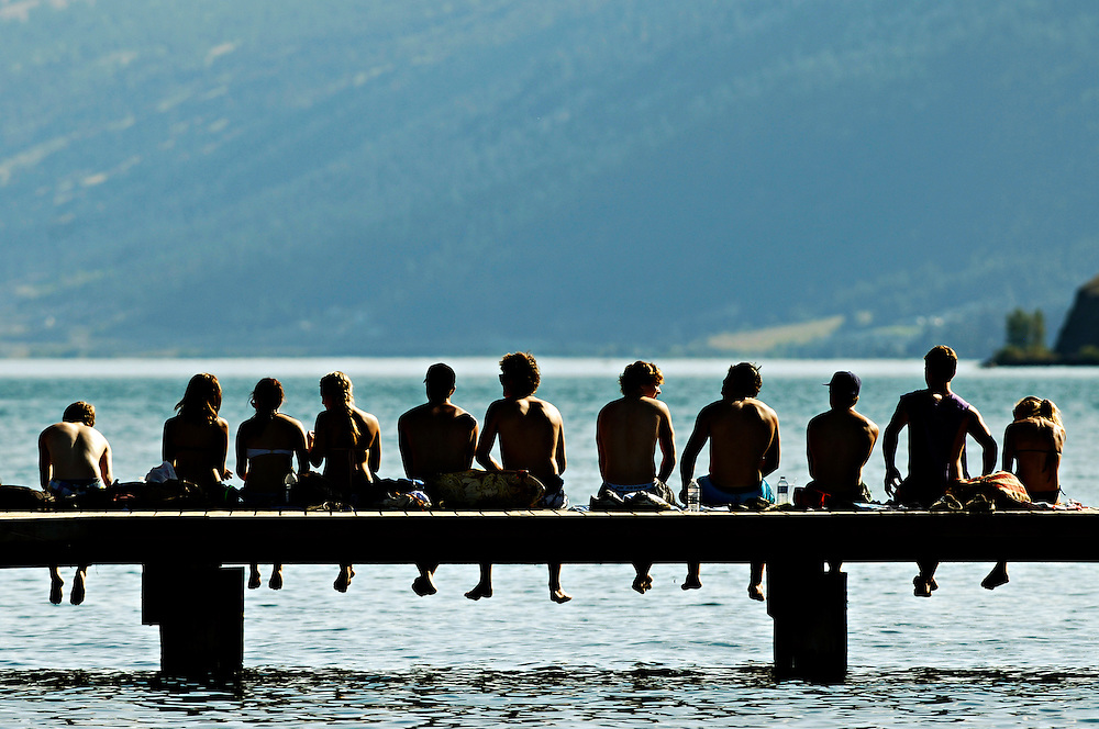 Youths take in the view of Kalamalka Lake in the Okanagan Valley on August 7, 2011.