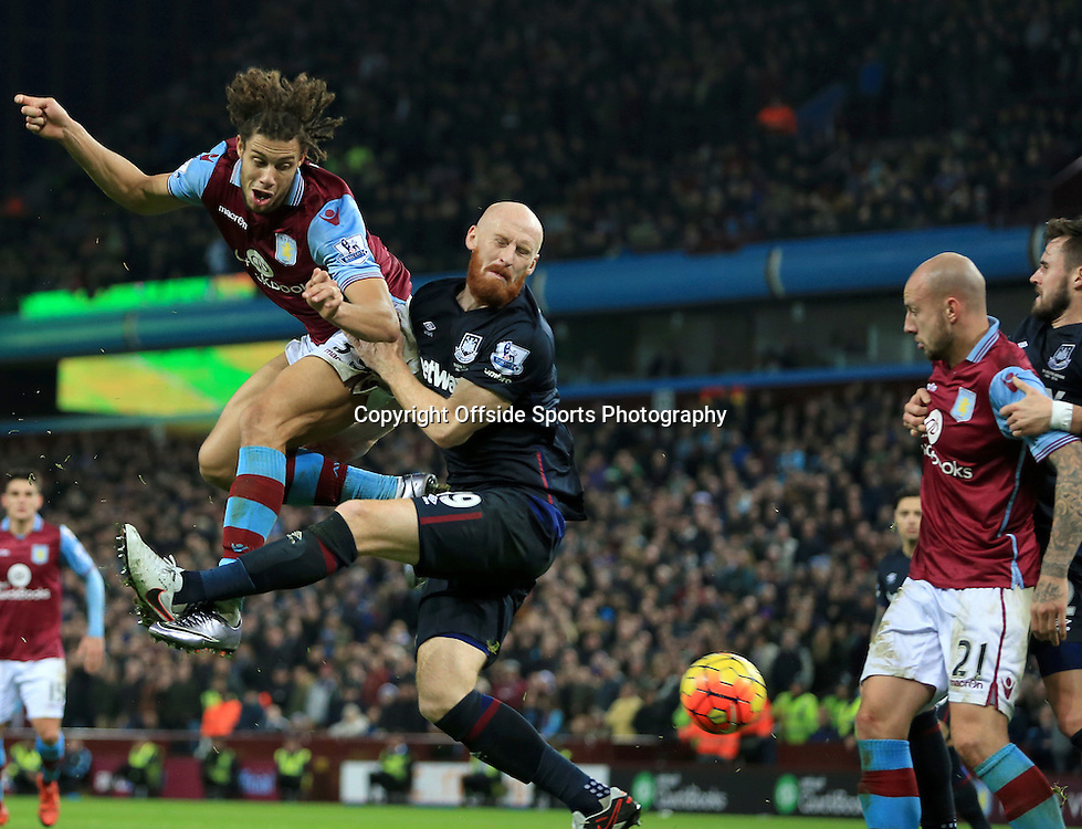 26th December 2015 - Barclays Premier League - Aston Villa v West Ham United - Rudy Gestede of Aston Villa gets a header in at goal under pressure from James Collins of West Ham United - Photo: Paul Roberts / Offside.