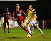 Northampton  midfielder Nicky Adams takes on Crawley defender Josh Yorwerth during the Sky Bet League 2 match between Crawley Town and Northampton Town at the Checkatrade.com Stadium, Crawley, England on 24 November 2015. Photo by David Charbit.