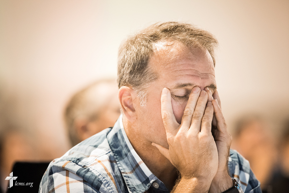 Lay voting delegate Jeffrey Mueller of Southern Illinois District rests his face in his hands during discussion of Resolution 12-01A from Floor Committee 12 on Monday, July 11, 2016, at the 66th Regular Convention of The Lutheran Church–Missouri Synod, in Milwaukee. LCMS/Michael Schuermann