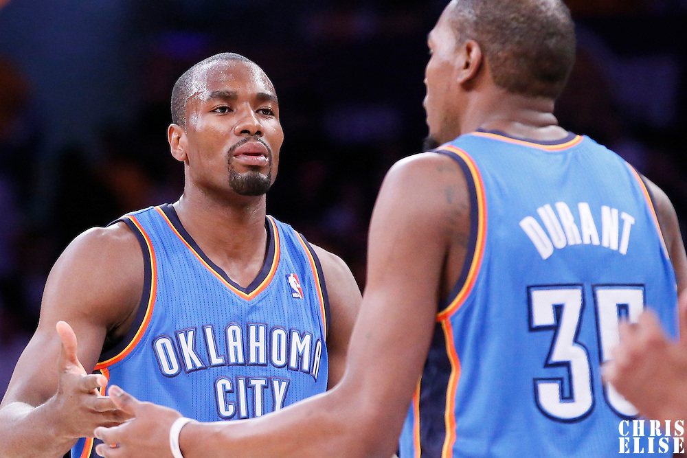 09 March 2014: Oklahoma City Thunder power forward Serge Ibaka (9) talks to Oklahoma City Thunder small forward Kevin Durant (35) during the Los Angeles Lakers 114-110 victory over the Oklahoma City Thunder at the Staples Center, Los Angeles, California, USA.