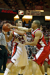 31 January 2004 Trey Guidry gets fouled while protecting possession of the ball.  Bradley University visit Redbird Arena in Normal Illinois, home of the Illinois State University Redbirds.