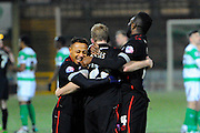 Carlisle Utd's penalty hero Mark Ellis is hugged by Carlisle Utd's Derek Asamoah and Carlisle Utd's Jabo Ibehre during the The FA Cup Third Round Replay match between Yeovil Town and Carlisle United at Huish Park, Yeovil, England on 19 January 2016. Photo by Graham Hunt.