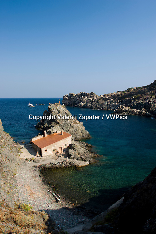 General view of Prona cove and fishers hut (Costa Brava). Cap de Creus Natural Park (Girona, Catalonia, Spain). Vista general de Cala Prona y la barraca de pescadores (Cadaqués, Costa Brava). Parc Natural del Cap de Creus.
