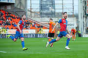 Joe Chalmers (#4) of Inverness Caledonian Thistle FC celebrates after scoring the opening goal during the William Hill Scottish Cup quarter final match between Dundee United and Inverness CT at Tannadice Park, Dundee, Scotland on 3 March 2019.