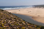 The southwest coast of Portugal, from cape St vincente, at the Algarve, until up to Zambujeira do Mar, at the Alentejo, is said to be among the most unspoiled coastlines of Europe. Although the touristic pressure is already very obvious at some spots, there are still plenty of beaches with almost no <br /> human marks. Bordeira is a rather vast beach, near the small villages of Bordeira and Carrapateira. To access the beach one has to cross the small river in its southmost end.