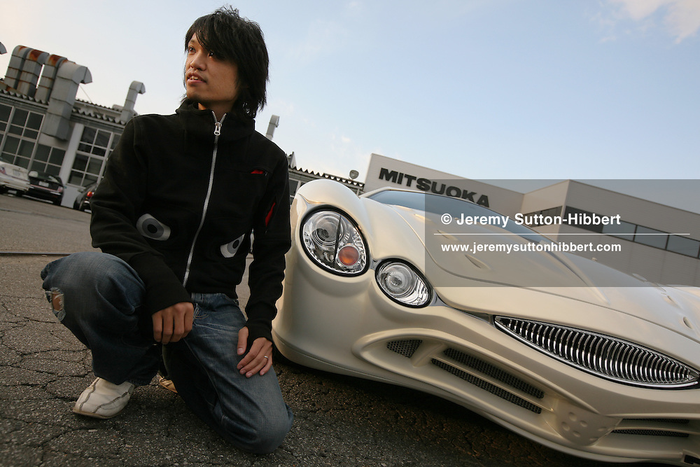 Takanori Aoki, the designer of the 'Orochi' car, stands beside an 'Orochi' car at the Mitsuoka car factory, near Toyama, Japan, Wednesday, November 14th, 2007.
