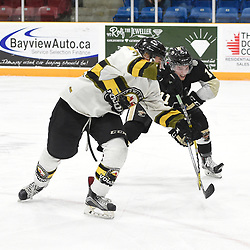 TRENTON, ON  - MAY 2,  2017: Canadian Junior Hockey League, Central Canadian Jr. &quot;A&quot; Championship. The Dudley Hewitt Cup. Game 2 between Powassan Voodoos and the Trenton Golden Hawks. Tyson Gilmour #23 of the Powassan Voodoos battles for the puck with Jordan Chard #11 of the Trenton Golden Hawks during the third period.<br /> (Photo by Andy Corneau / OJHL Images)