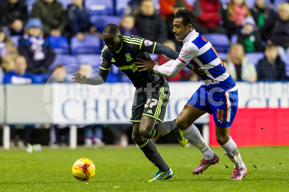 Albert Adomah of Middlesbrough grapples with Jordan Obita of Reading during the 1-1draw during the Sky Bet Championship match between Reading and Middlesbrough at the Madejski Stadium, Reading, England on 10 January 2015. Photo by Gareth  Brown.