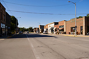 "03 AUGUST 2020 - JEWELL, IOWA:  Main Street in Jewell, IA. The only grocery store in Jewell, a small community in central Iowa, closed in 2019. It served four communities within a 20 mile radius of Jewell. Some of the town's residents created a cooperative to reopen the store. They sold shares to the co-op and  held fundraisers through the spring. Organizers raised about $225,000 and bought the store, which had its ""soft opening"" July 8. The store celebrated its official reopening Monday August 3. Before the reopening, Jewell had been a ""food desert"" for seven months. The USDA defines rural food deserts as having at least 500 people in a census tract living 10 miles from a large grocery store or supermarket. There is a convenience store in Jewell, but it sells mostly heavily processed, unhealthy snack foods that are high in fat, sugar, and salt.            PHOTO BY JACK KURTZ"