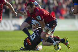 December 9, 2018 - Limerick, Ireland - CJ Stander of Munster tackled by Benjamin Udrapilleta of Castres during the Heineken Champions Cup Round 3 match between Munster Rugby and Castres Qlympique at Thomond Park Stadium in Limerick, Ireland on December 9, 2018  (Credit Image: © Andrew Surma/NurPhoto via ZUMA Press)