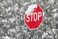 Middletown, New York - Snow accumulates on a stop sign during a snowstorm on Feb. 9, 2017.