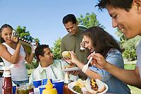 Family at outdoors picnic.
