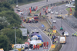 © Licensed to London News Pictures. 23/08/2015. Shoreham, UK.  Emergency services at the scene where a Hawker Hunter fighter jet crashed in to cars on the A27 road in front of thousands of spectators at the Shoreham Airshow in West Sussex with 7 people confirmed dead. Today August 23rd 2015. Photo credit : Hugo Michiels/LNP
