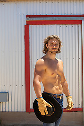 hot shirtless cowboy by a metal barn