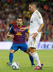 17.08.2011, Camp Nou, Barcelona, ESP, Supercup 2011, FC Barcelona vs Real Madrid, im Bild FC Barcelona's Xavi Hernandez (l) and Real Madrid's Karim Benzema during Spanish Supercup 2nd match.August 17,2011. EXPA Pictures © 2011, PhotoCredit: EXPA/ Alterphotos/ Acero +++++ ATTENTION - OUT OF SPAIN / ESP +++++