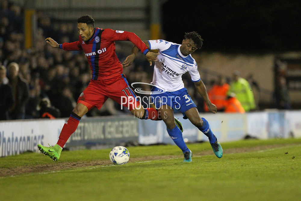 Nathaniel Mendez-Laing challenged by Greg Leigh during the EFL Sky Bet League 1 match between Bury and Rochdale at the JD Stadium, Bury, England on 13 April 2017. Photo by Daniel Youngs.