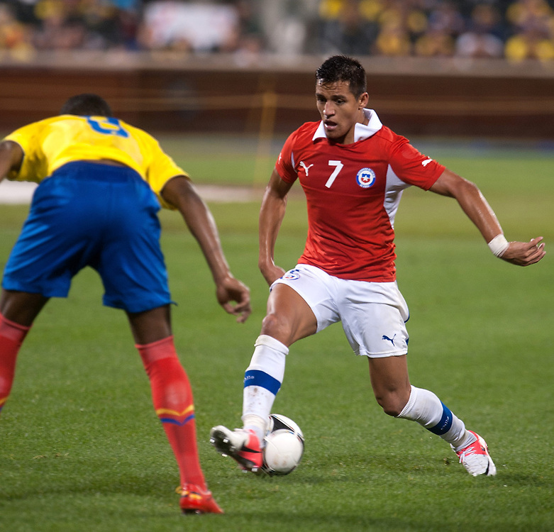 Ecuador's Fricson Erazo tries to stop Chile's Alexis Sanchez during an international friendly between Ecuador vs Chile at CitiField in NYC.