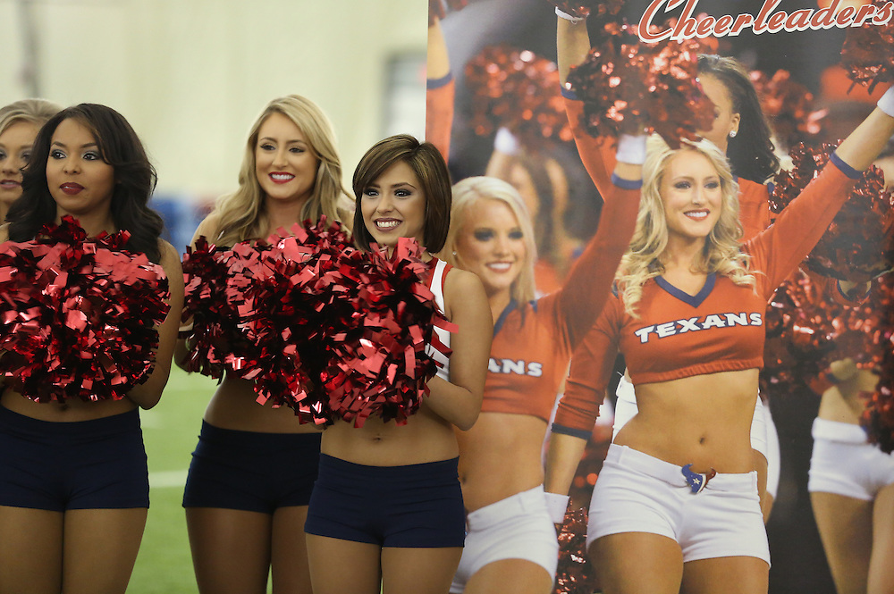 4/16/2014: Newly announced cheerleaders smile as another name is called. Fifty girls showed up on April 16, 2014 at the Houston Texans practice facility in Houston, Texas to see which 35 girls made the 2014-2015, Houston Texans Cheerleading Team.