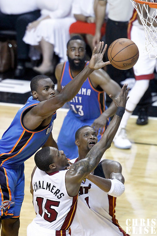 19 June 2012: Miami Heat point guard Mario Chalmers (15) goes for the layup past Oklahoma City Thunder power forward Serge Ibaka (9) during the Miami Heat 104-98 victory over the Oklahoma City Thunder, in Game 4 of the 2012 NBA Finals, at the AmericanAirlinesArena, Miami, Florida, USA.