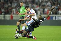 FOOTBALL - FRENCH CHAMPIONSHIP 2011/2012 - L1 - PARIS SAINT GERMAIN v OLYMPIQUE LYONNAIS - 2/10/2011 - PHOTO JEAN MARIE HERVIO / DPPI - DEJAN LOVREN (OL) / MOHAMED SISSOKO (PSG)