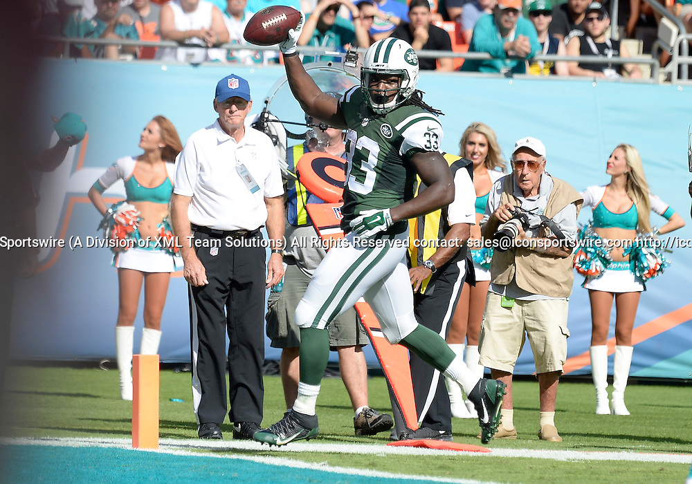 28 December 2014: New York Jets Running Back Chris Ivory (33) [13171] scores against the Miami Dolphins in the Jet's 37-24 victory at Sun Life Stadium, Miami, Florida.