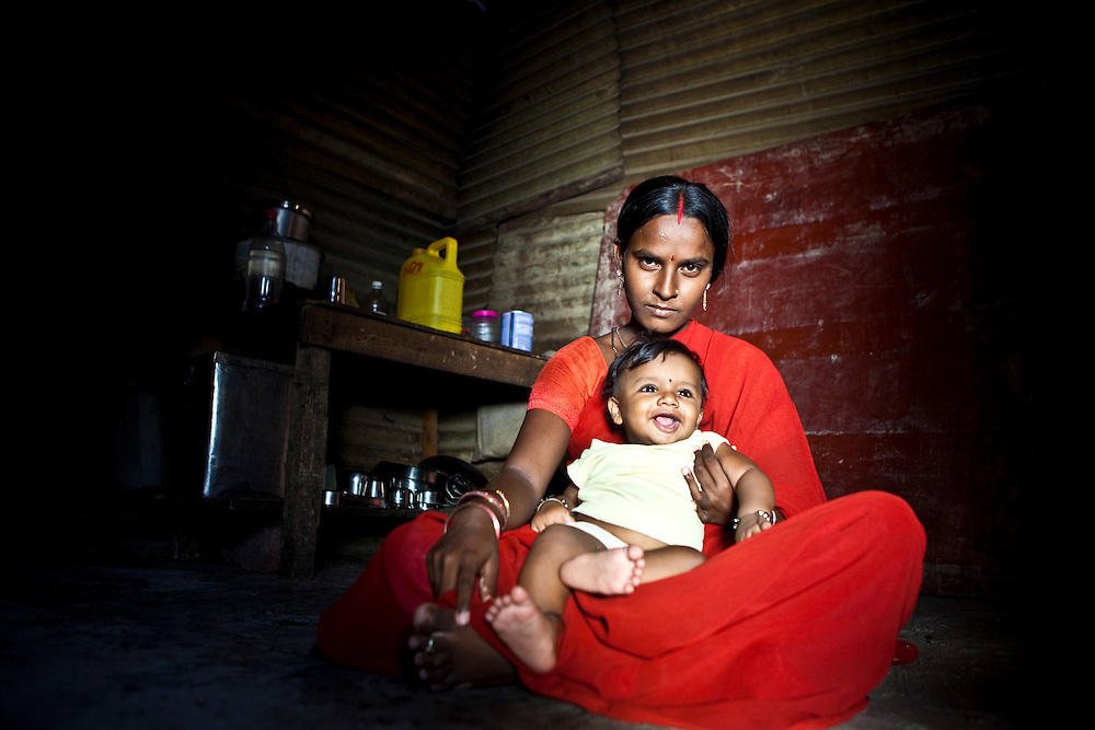 Sheetal Mandan - Age 9 months with her mother.  They live in a small tin shack on the construction site.  At the construction site is the Agripada Centre that is run by the Mumbai Mobile Crèche organisation.