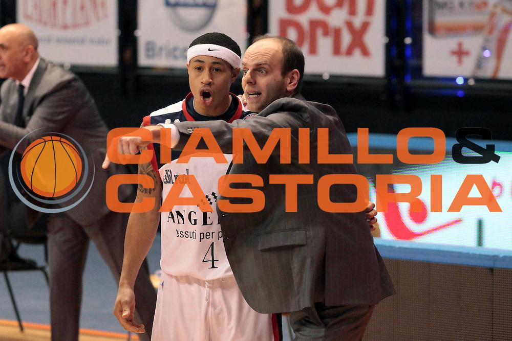 DESCRIZIONE : Biella Lega A 2010-11 Angelico Biella Dinamo Sassari<br /> GIOCATORE : Massimo Cancellieri A J Slaughter<br /> SQUADRA : Angelico Biella<br /> EVENTO : Campionato Lega A 2010-2011<br /> GARA : Angelico Biella Dinamo Sassari<br /> DATA : 20/02/2011<br /> CATEGORIA : Delusione<br /> SPORT : Pallacanestro<br /> AUTORE : Agenzia Ciamillo-Castoria/S.Ceretti<br /> Galleria : Lega Basket A 2010-2011<br /> Fotonotizia : Biella Lega A 2010-11 Angelico Biella Dinamo Sassari<br /> Predefinita :