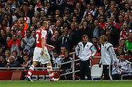 Mathieu Debuchy of Arsenal leaves the field after being sent off against Besiktas J.K. during the UEFA Champions League match at the Emirates Stadium, London<br /> Picture by David Horn/Focus Images Ltd +44 7545 970036<br /> 27/08/2014