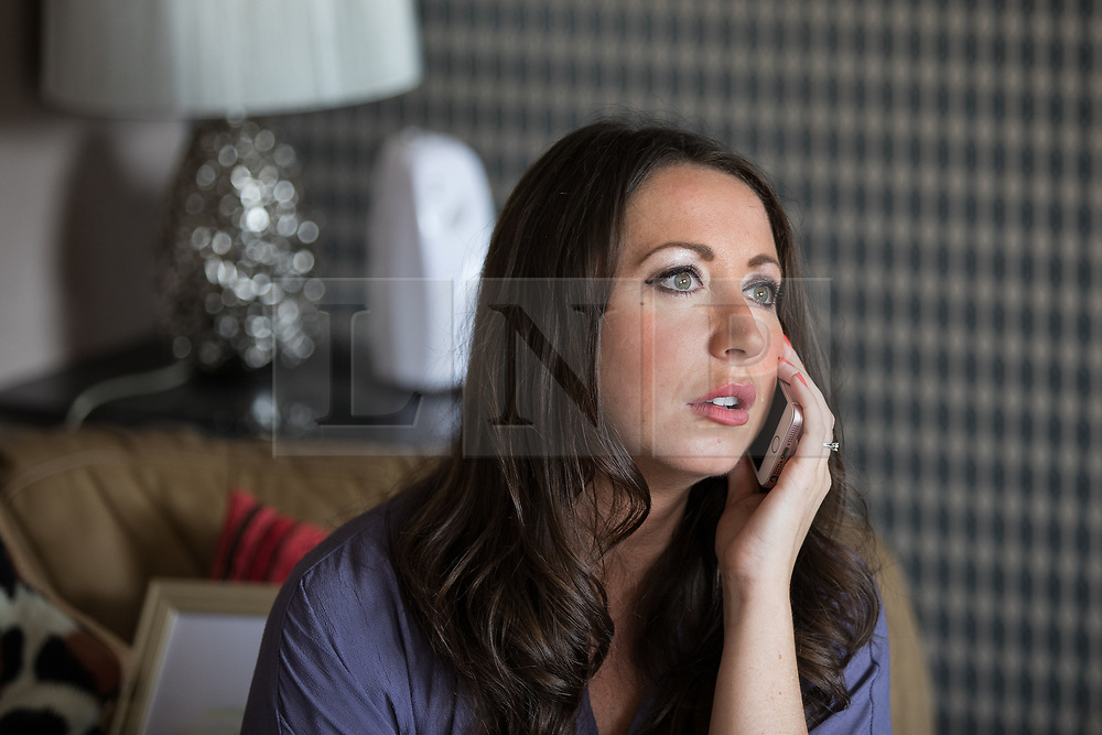 © Licensed to London News Pictures . 06/07/2017 . Manchester , UK . PAULA WILLIAMSON receives a call from Charles Salvador . Artwork by convicted criminal  Charles Salvador (previously Charles Bronson) has been sold on behalf of Salvador to raise a £1,000 to support Barbara and Len Dransfield . Barbara , who has become friendly with Salvador , was brought the money and a card by Salvador's fiance , Paula Wiliamson . Barbara Dransfield was brutally assaulted by masked robbers as she sat at home in her wheelchair . She suffered extensive injuries to her face and body . Photo credit : Joel Goodman/LNP