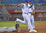 Sep 25, 2015; Kansas City, MO, USA; Kansas City Royals pitcher Edinson Volquez (36) outruns Cleveland Indians base runner Francisco Lindor (12) to first base for the final out of the top of the fifth inning at Kauffman Stadium. Mandatory Credit: Peter G. Aiken-USA TODAY Sports